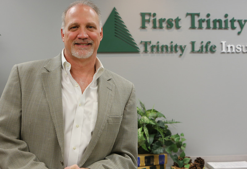 First Trinity Financial CEO Gregg Zahn pauses for a photo at the companies Tulsa Office.