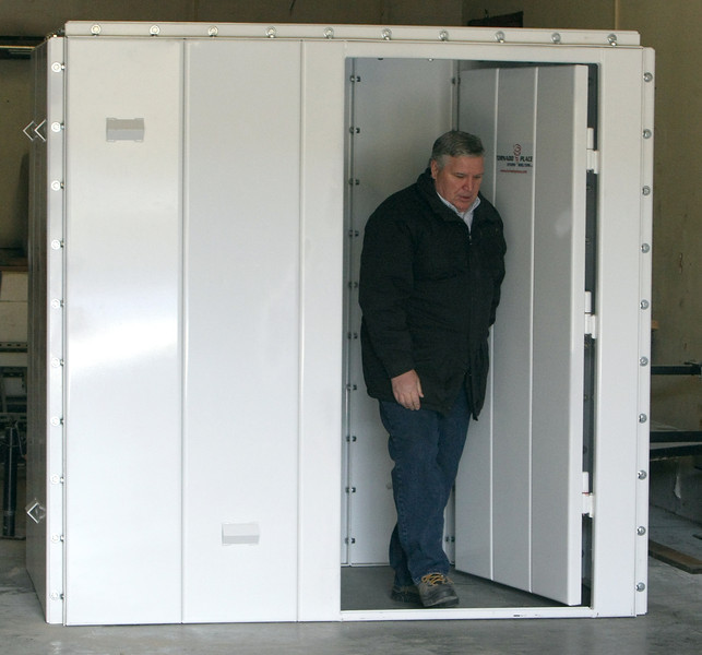 Dan Threlkeld in the shop where his companies tornado shelters are produced.