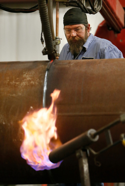 Welder David Halencak at Tulsa's Pipeline Equipment works to produce a valve used on the KeystoneXL pipeline.