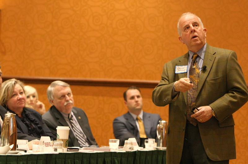 Audience members at the GTAR conference listen as Bruce Bozle gives his presentation.