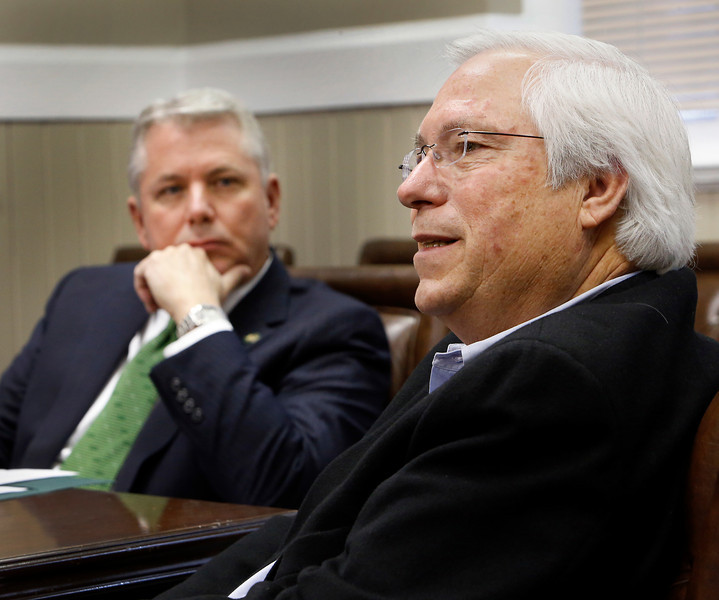 Steve Turner, President to Northeastern State University listens as Principal Chief of the Cherokee Nation Bill John Baker discusses the resurgence of the city of Tahlequah.