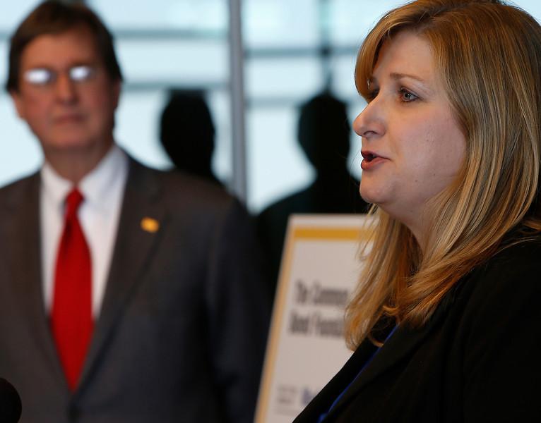 Tulsa Mayr Dewey Bartlett looks on as Karen Pennington<br /> Program Director at Madison Strategies announces a 250K donation to continue the groups career training efforts.