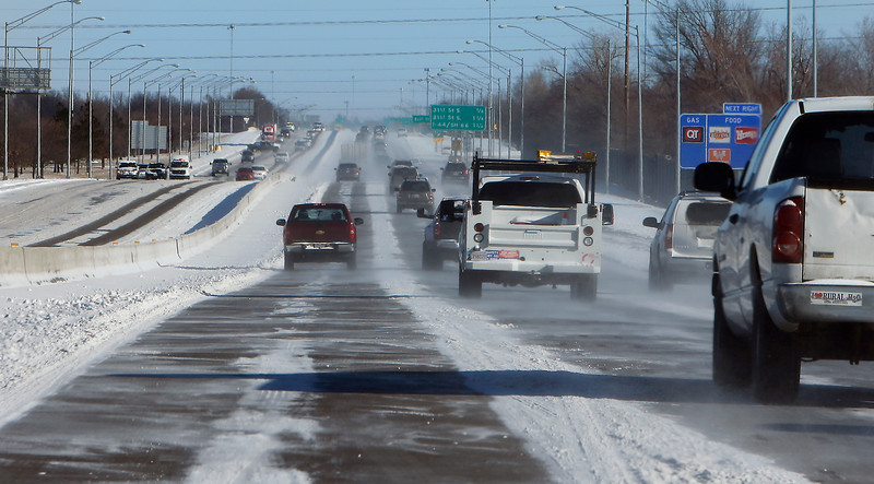 Commuters battle the elements on HWY 169 on their morning commute Monday.