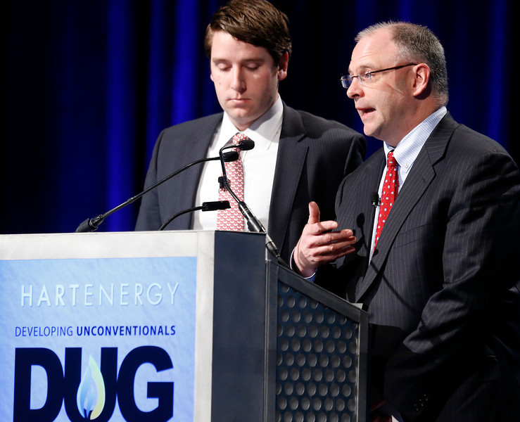 Craig Borque and Shaun Finnie  of the Evercore Group give their presentation at the DUG conference in Tulsa.