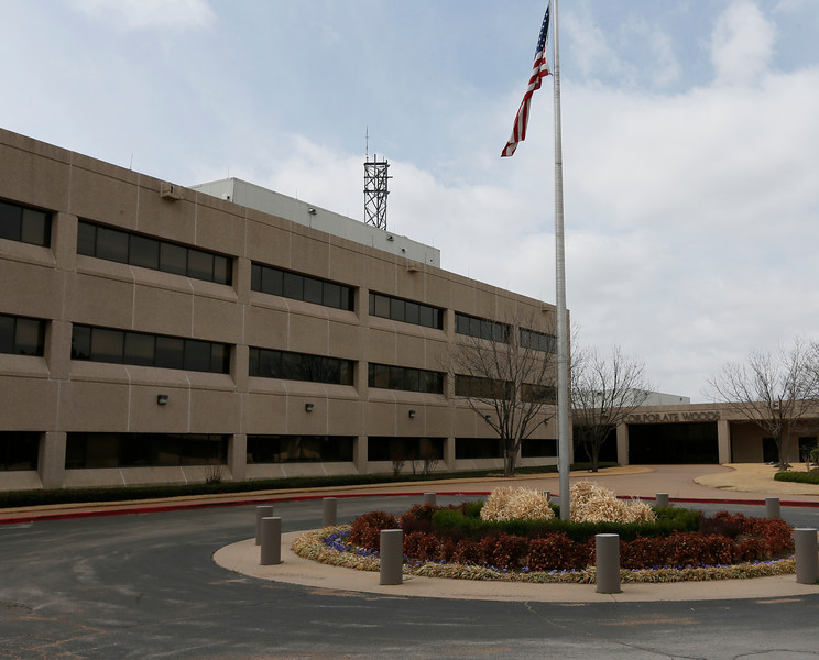 A photograph of Tulsa's Corporate Woods office complex and the headquarters of Osage, LLC.