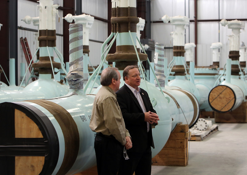 TransCanada's Vice-President of Keystone Projects Corey Goulet and Tulsa's Pipeline Equipment President Jack Lollis chat with the media while inspecting valves produced for the project.