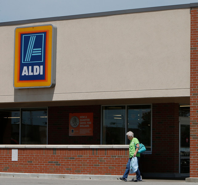 Customers at the Aldi grocery store in Bixby.
