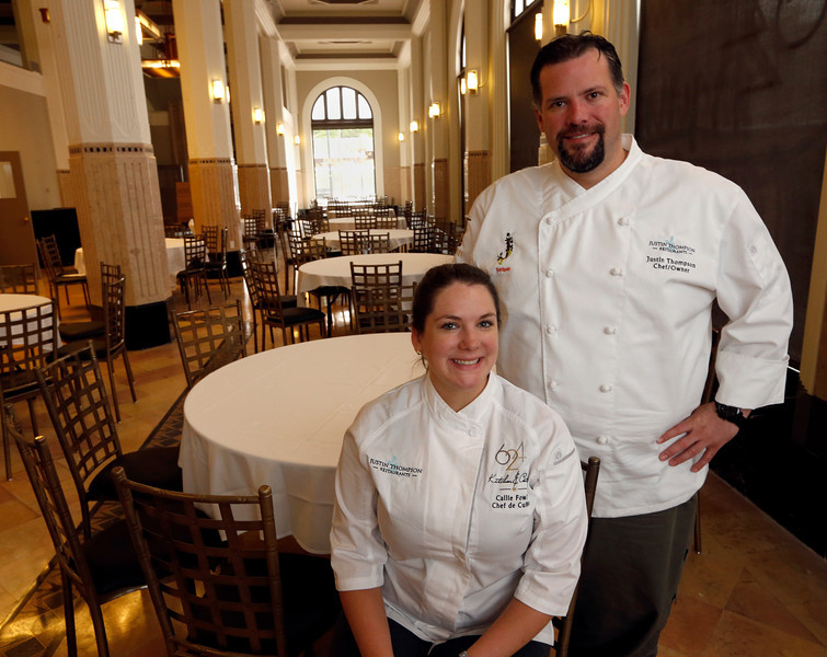 Justin Thompson (R) and chef Callie Fowler pause for a photo at the 624 Kitchen and Catering location in downtown Tulsa.