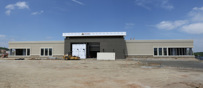 Construction continues on the Ashley Furniture showroom at the Tulsa Hills Shopping Center in West Tulsa.
