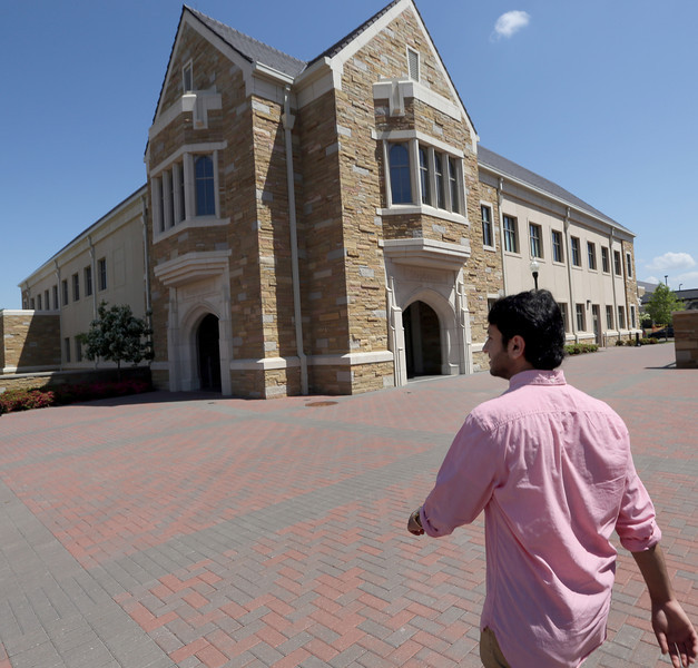 Yousef Ameen, Saudi petroleum engineering student at the University of Tulsa walks across campus on the way to the Engineering building Friday.