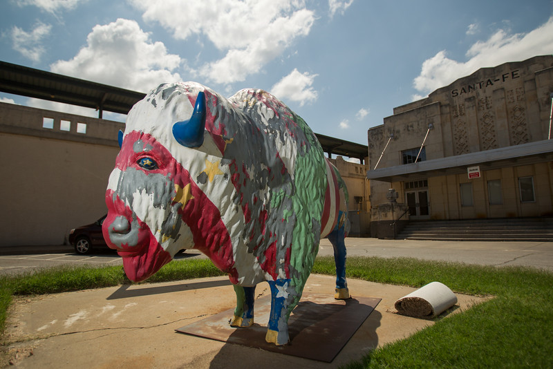 One of Oklahoma City's painted buffalo with paint worn off by time.