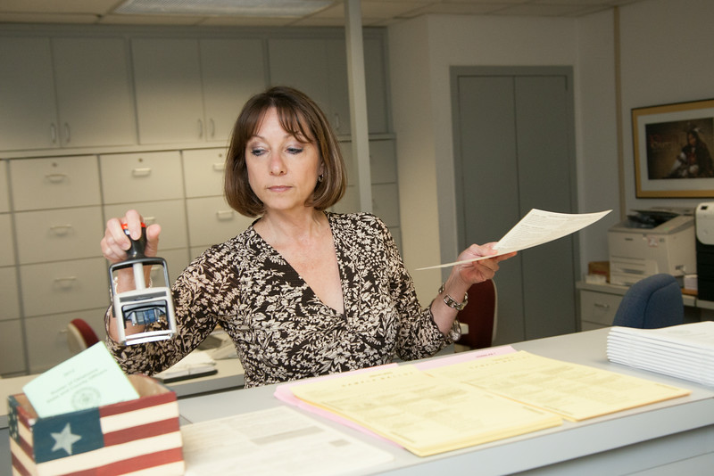 Angela Wood stamps and files a voter regisration form at the Oklahoma Election Board at the state capitol.