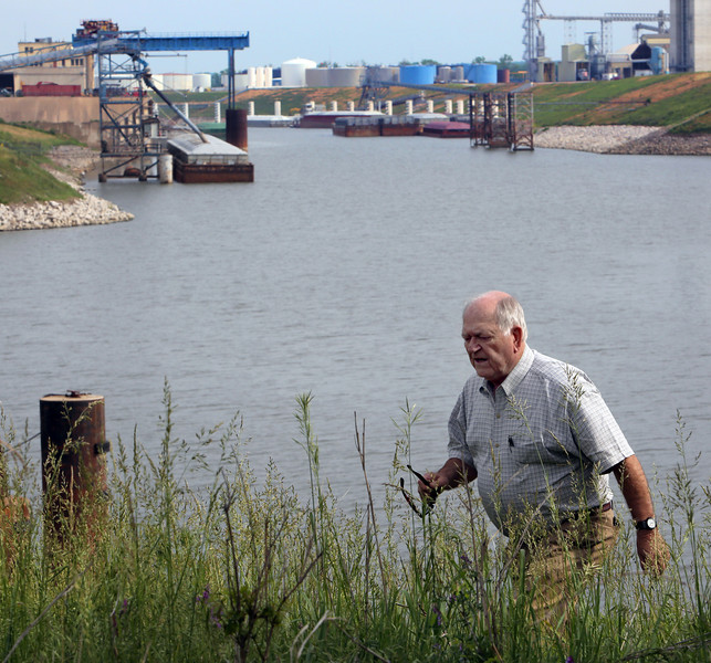 Port of Catoosa Director Bob Portiss inspects a section of the channel that could be effected if a bill on its way to President Barack Obama's desk is signed would allow expansion to  attract industrial growth to the region.