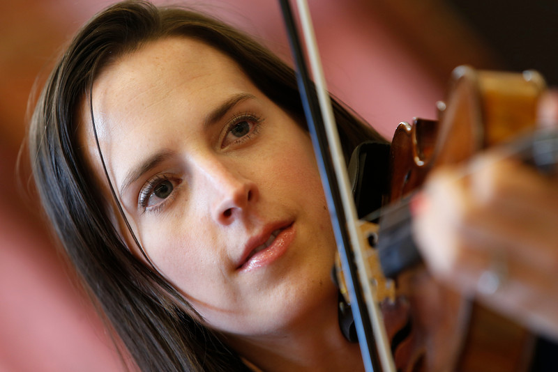 Kelley Mason practices on her violin.