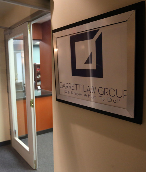 Tulsa's Garrett Law Office and Norman's Bell Law Firm are in a dispute over a workers compensation case payment.
