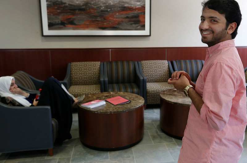 Yousef Ameen, Saudi petroleum engineering student at the University of Tulsa Chats with a friend.