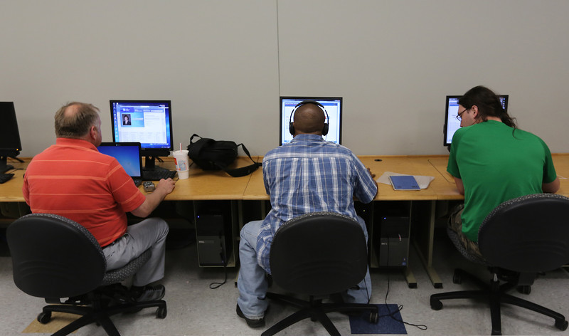 Students work on research at the TCC  Workforce Development fast-track training class for entry level manufacturing jobs.