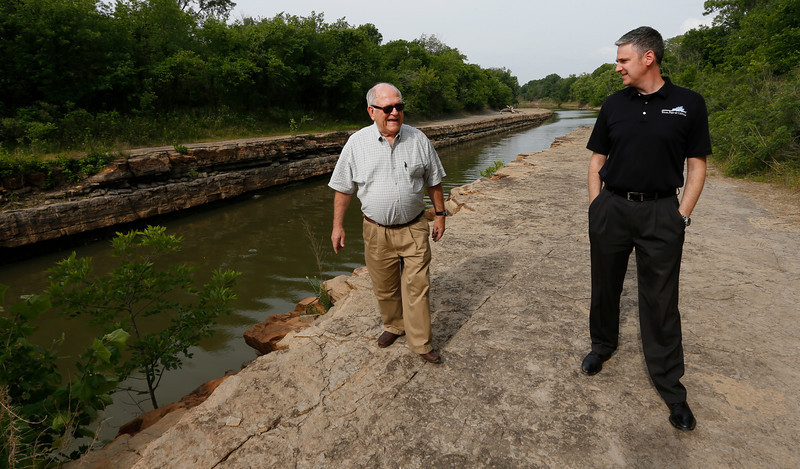 Port of Catoosa Director Bob Portiss and Port Deputy Director David Yarbrough inspect a section of bird creek that could be effected if a bill on its way to President Barack Obama's desk is signed would allow expansion to  attract industrial growth to the region.