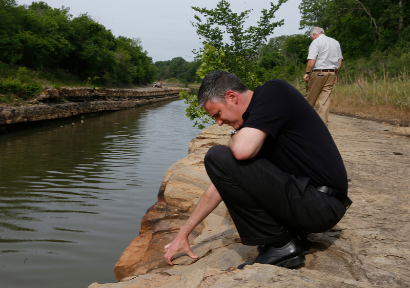 Port of Catoosa Deputy Director David Yarbrough and Director Bob Portiss inspect a section of bird creek that could be effected if a bill on its way to President Barack Obama's desk is signed would allow expansion to  attract industrial growth to the region.