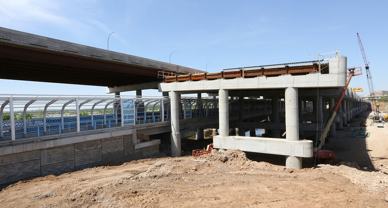 Construction workers work on a support for the I-244 intermodal bridge project in Tulsa.