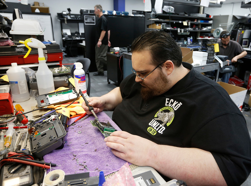 Technician Nick DiCini of Touchstar repairs electronics at the companies Tulsa location.