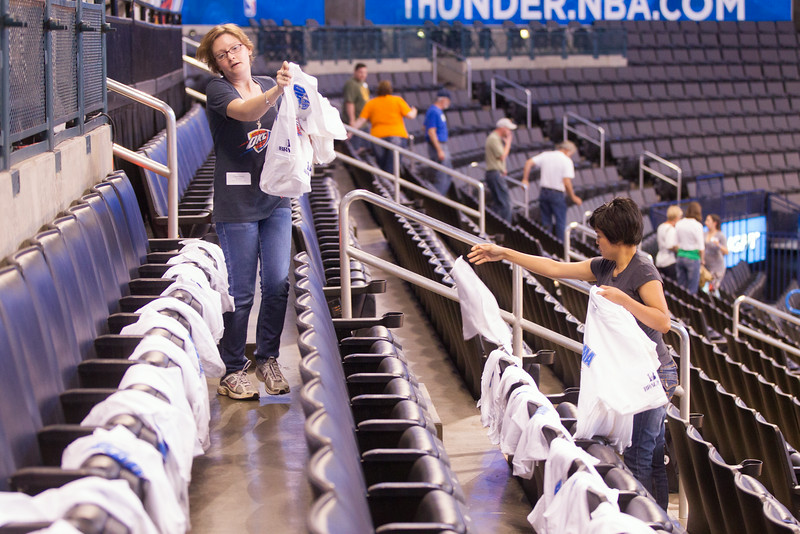 Volonteers distribute playoff tshirts before a OKC Thunder game at the Chesapeak Arena.