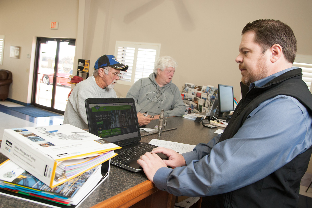 Jermey Wilcox with Precision Fitting and Gauge preparing to demonstrate to a customer how to use their new online ordering system.