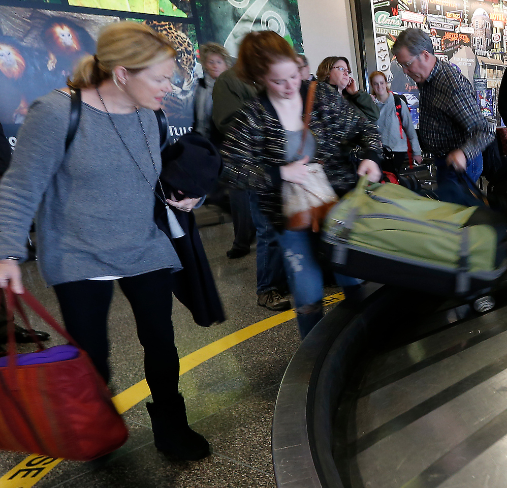 Arriving for a holiday visit  the Pringle family collects their bags at Tulsa International Airport.