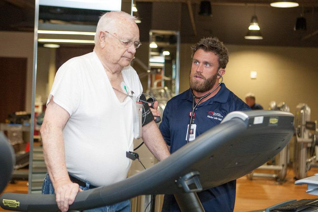 Exercise physiologists Adam Wanner works with heart patient Fred Peck at the Oklahoma Heart Hospitals new fitness center.