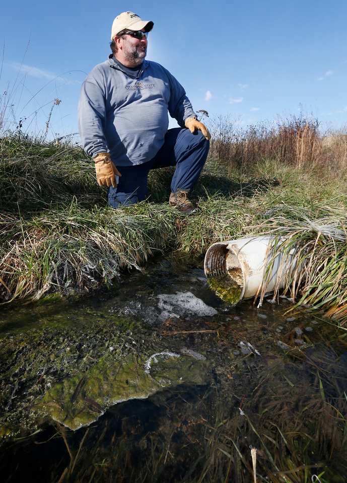 Bob Nairn studies his passive wetland project which through series of 5 filtration ponds drastically  reduced heavy metals that drain out from abandoned mines.<br /> <br /> This is the discharged water that runs into Tar Creek.