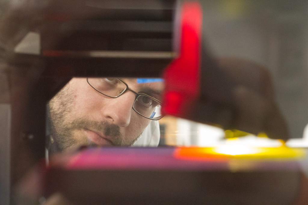 Peter Wolbach, assistant coordinator at Rose State Collage's Fab Lab, checks a 3D printer design in progress.