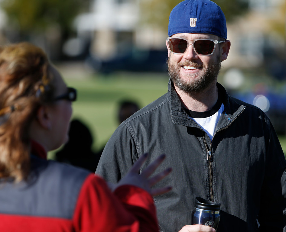Rob Hanigan, President of the Tulsa University Student Veterans Association chats with friends prior to the SMU football game Saturday.