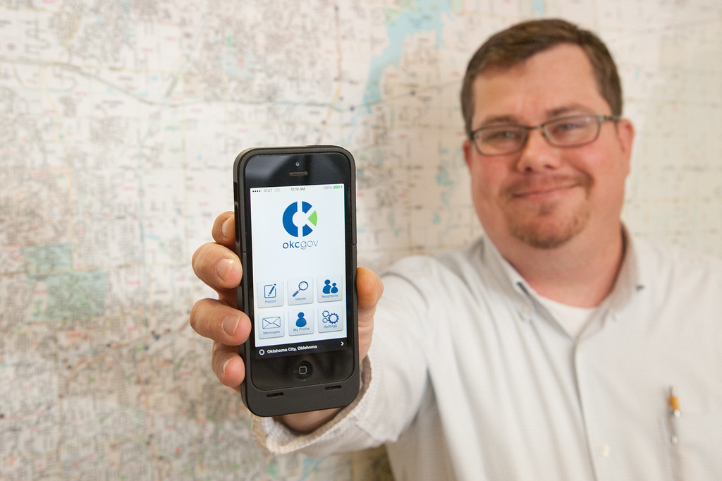 Zack Nash showing the OKCgov app for reporting issues across Oklahoma CIty.