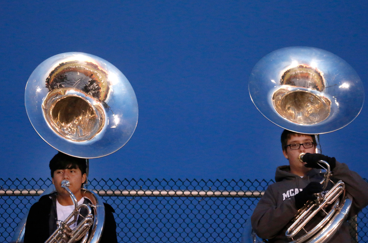 During a recent high school football game between McAlester and Bishop Kelly tuba players with the McAlester band watch the game.
