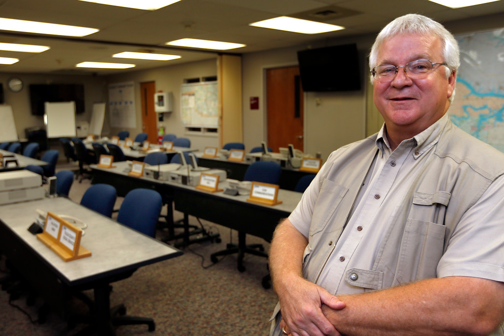 Roger Jolliff, Director of the Tulsa Area Emergency Management Agency, pauses for a photograph in the emergency operations center.