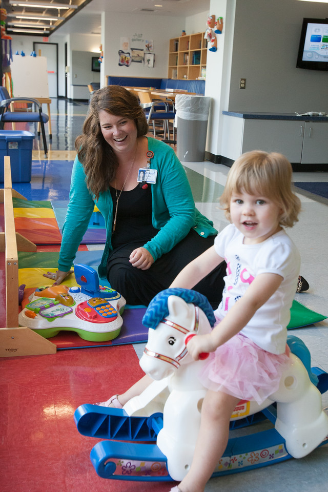 Child Life Specialist Jocelyn Taylor playing with Scarlett at Children's Hospital in Oklahoma City, OK.
