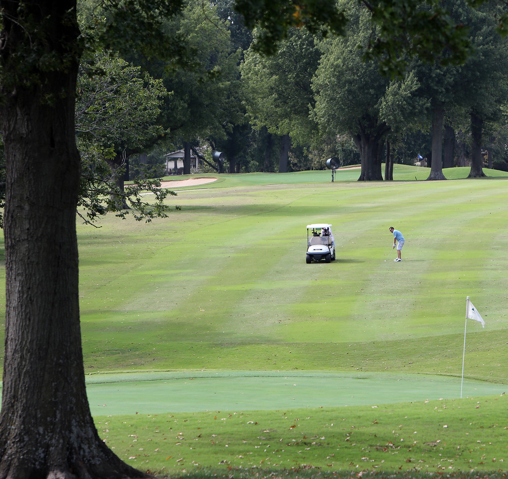 Members take advantage of the fall weather to get in a round at the Meadowbrook Country Club in Tulsa.