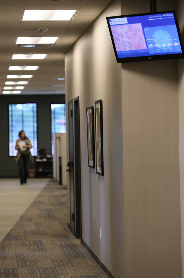 Electronic information boards are located in all the main hallways of HoganTaylor in Tulsa.