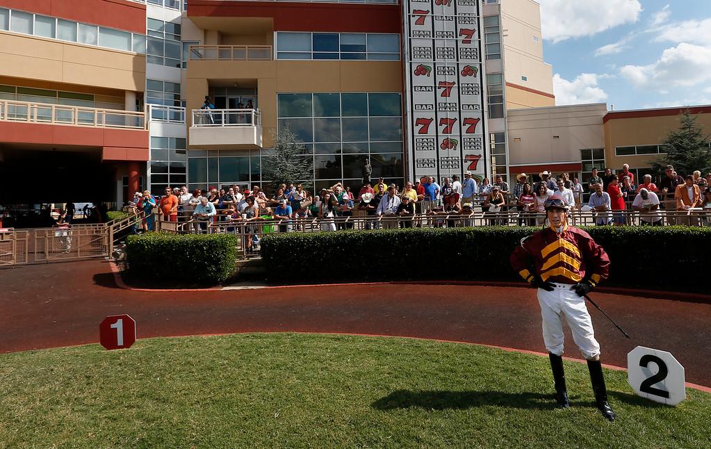 Jockey Glen Murphy waits for mount Nublado Bling prior to the Kip Deville Stakes race at Remington Park.