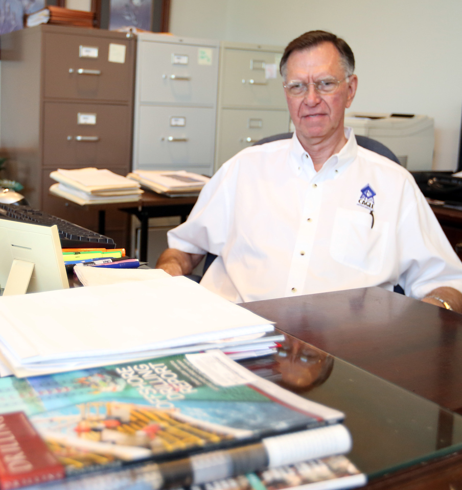 Bill Cagle of Cagle Oilfield Service pauses for a photo at his Tulsa office.