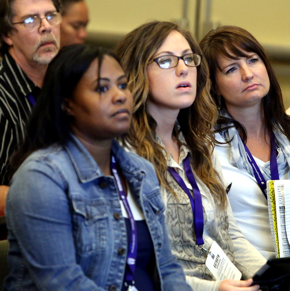 Audience members listen to a presentation on prescription drug addiction in Oklahoma during the 20th Annual Zarrow Symposium in Tulsa.