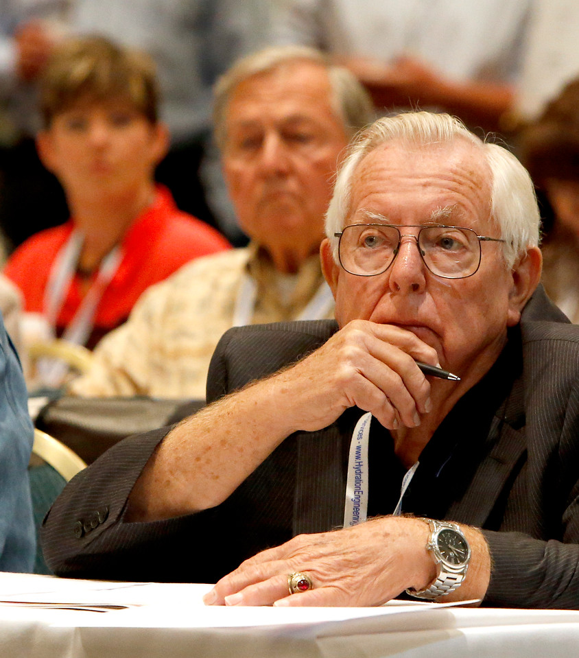 Audience members listen as Charles Hurlvurt of the Bureau of Indian Affairs in Osage County auctions leases at the Osage oil and gas summit and lease sale in Tulsa.<br /> <br /> Served as auctioneer Charles Hurlvurt
