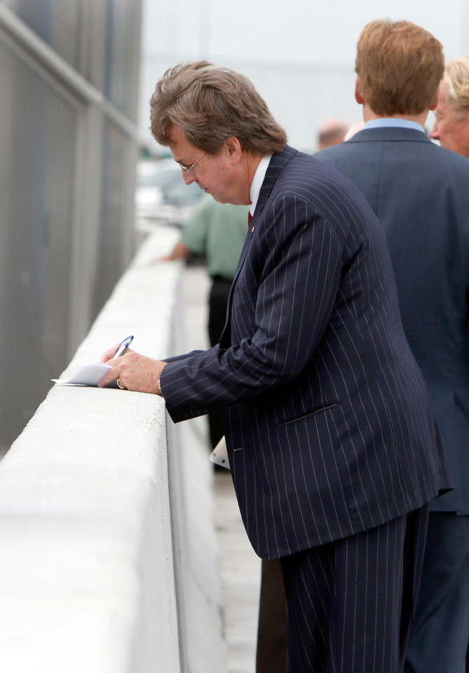 Mayor Dewey Bartlett makes notes to his speech prior to  the ceremony officially opening the I-244 bridge over the Arkansas River near downtown Tulsa.