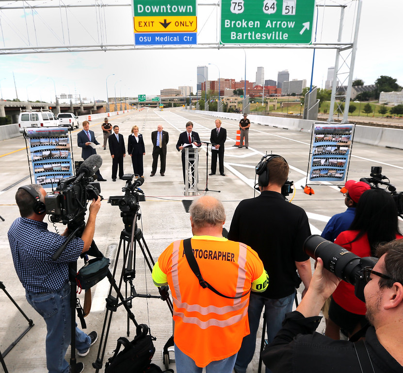 Journalists cover at the ceremony officially opening the I-244 bridge over the Arkansas River near downtown Tulsa.
