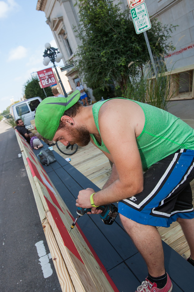 "Peter Holden works on a ""parklet"" at Frontline Church at 1104 N. Robinson Ave. Better Block OKC organized the outdoor spaces throughout Oklahoma City as part of national Parking Day. Parklets are open to the public and will be up through Sept. 21."