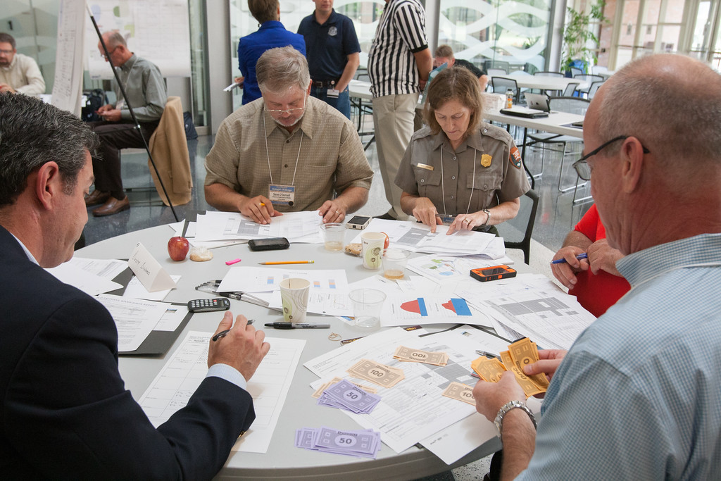 Officials from around the state to participate in water managemet exercises using Monopoly as their currency. The event was hosted by the Oklahoma Water Resource Board  and held at the National Weather Center in Norman, OK.