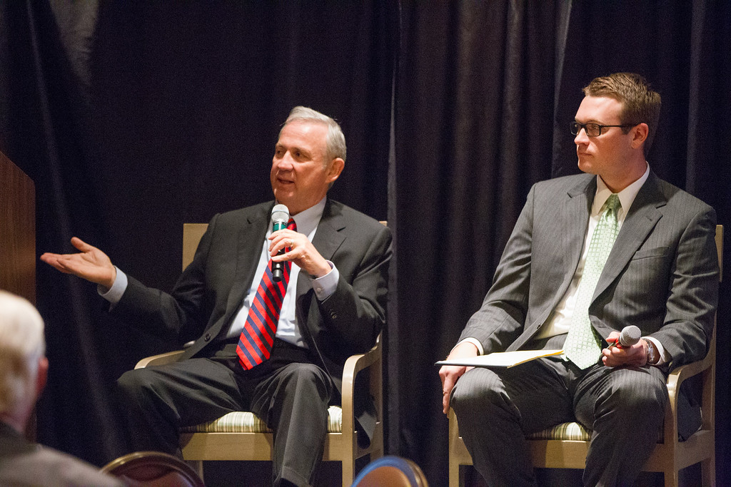 Mickey Clagg, president of Midtown Renaissance Group, and Harry Hughes, vice president of Millhouse Ventures, participated in a forum on downtown devolopment at the Greater Oklahoma City Chamber of Commerce luncheon.
