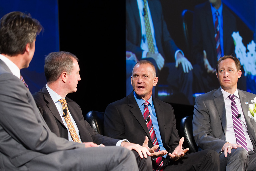 Jim Roth (left), with Phillips Murrah, moderated a the Leading Innovators Panal at the Governer's Energy Conferance in Oklahoma CIty. Panel members were Eric Gebhardt with GE Oil and Gas, William Patric with Seaboard Farms, and Lance W. Robertson with Marathon Oil.