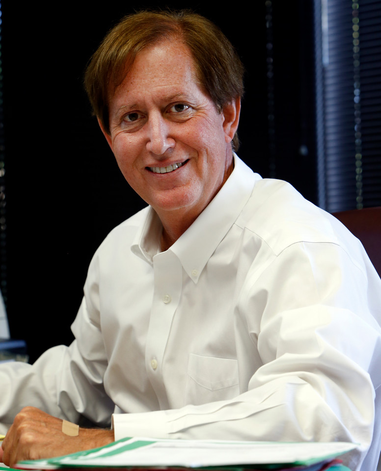 Steve Milam pauses for a photograph at his south Tulsa office.