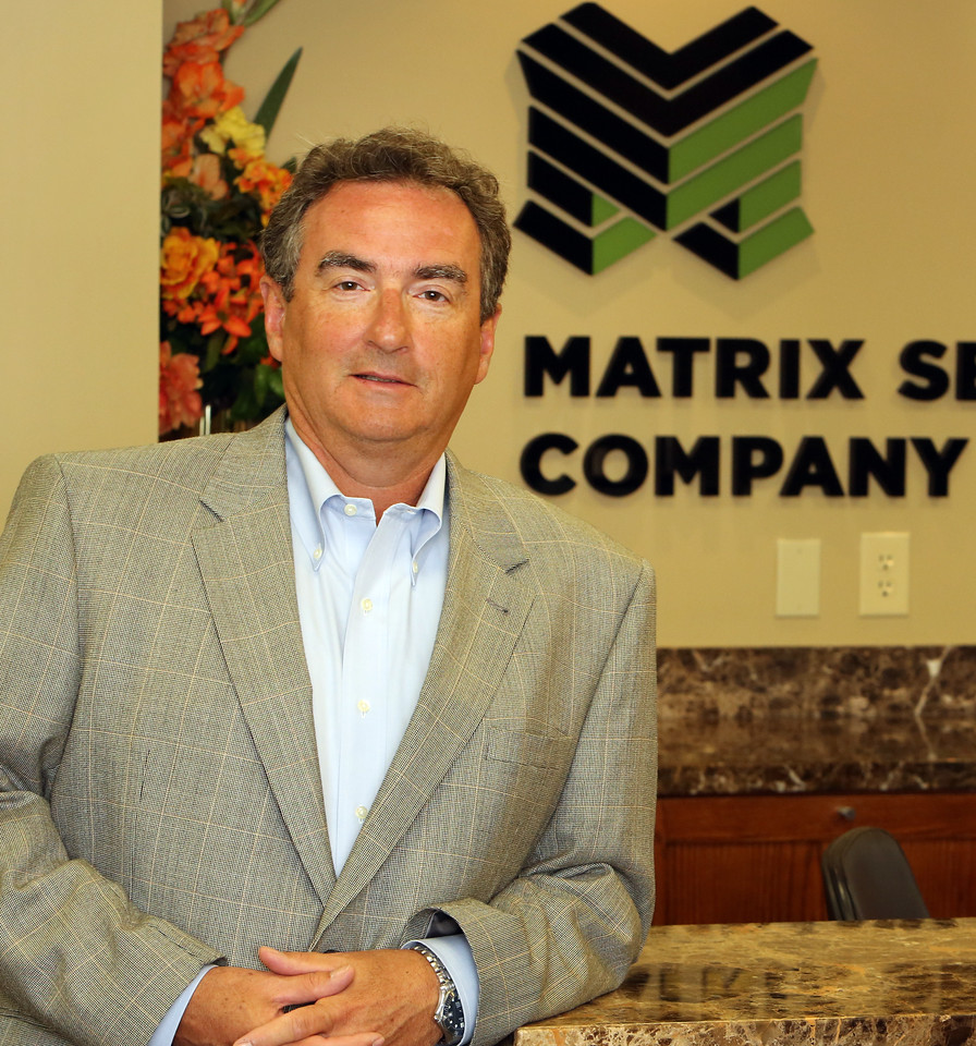 John Hewitt , CEO of the Matrix Service Company, pauses for a photo at the companies Tulsa Office.